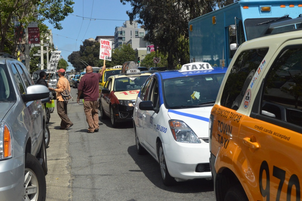 Taxi drivers protest rideshares as government mulls new