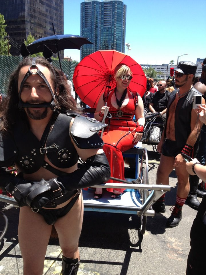 Lady in red: What this year's Pride leather marshal wore