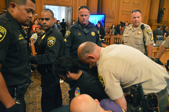 Nonprofit workers shout down Board of Supervisors meeting, 11 detained